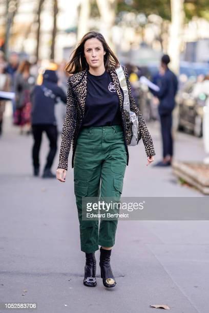 A guest wears a leopard print blazer jacket a black top green pants outside Haider Ackermann during Paris Fashion Week Womenswear Spring/Summer 2019...