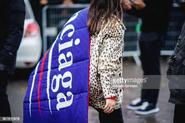 A guest wears a leopard print coat and a Balenciaga puffer coat outside Dior during Paris Fashion Week Menswear Fall Winter 20182019 on January 20...