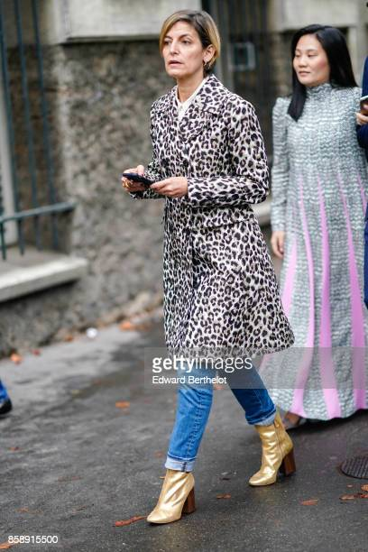 A guest wears a leopard print coat blue jeans brown shoes outside Valentino during Paris Fashion Week Womenswear Spring/Summer 2018 on October 1 2017...