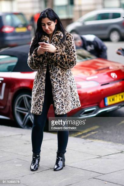 A guest wears a leopard print coat during London Fashion Week Men's January 2018 at on January 6 2018 in London England
