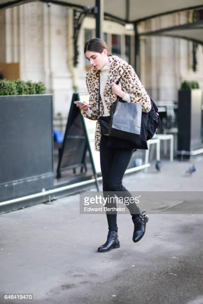 A guest wears a leopard print fur coat outside the Olivier Theyskens show during Paris Fashion Week Womenswear Fall/Winter 2017/2018 on February 28...