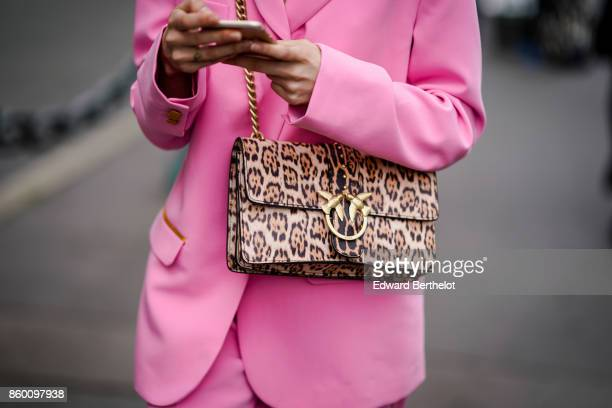 A guest wears a leopard print JW anderson bag a pink pantsuit outside the Dries Van Noten show during Paris Fashion Week Womenswear Spring/Summer...