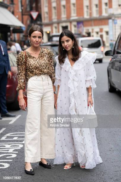 A guest wears a leopard print shirt cream trousers and flat shoes with Personal Shopper and digital influencer Bettina Looney wearing a WinWingtage...