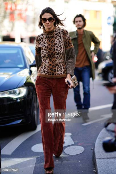 A guest wears a leopard print top outside Acne Studios during Paris Fashion Week Womenswear Spring/Summer 2018 on September 30 2017 in Paris France