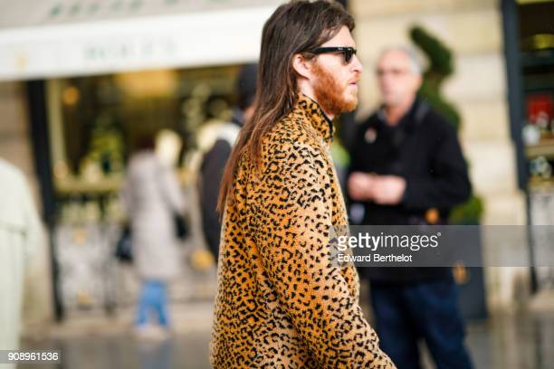 A guest wears a leopard print top outside Schiaparelli during Paris Fashion Week Haute Couture Spring/Summer 2018 on January 22 2018 in Paris France