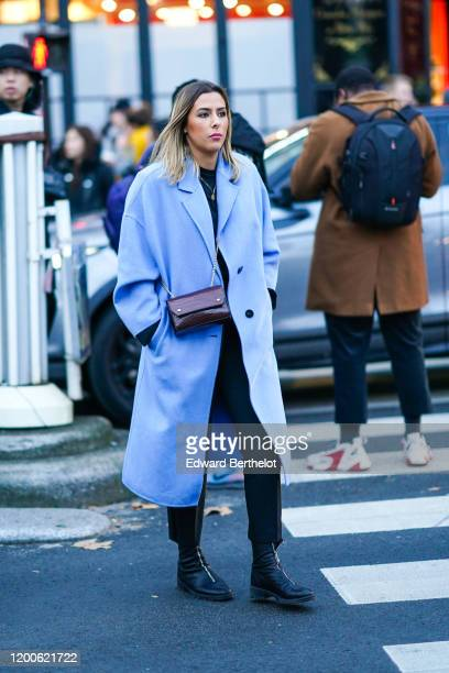 A guest wears a light blue coat a brown croceffect bag black pants black boots outside Paul Smith during Paris Fashion Week Menswear Fall/Winter...