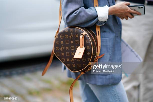 A guest wears a light blue jacket a Louis Vuitton monogram bag outside Hermes during Paris Fashion Week Menswear Spring/Summer 2020 on June 22 2019...