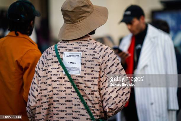 A guest wears a light brown bob hat a peachcolor Vetements trench coat outside Rochas during Paris Fashion Week Womenswear Fall/Winter 2019/2020 on...