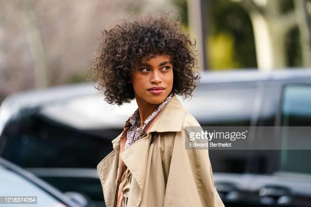 Guest wears a light brown trench coat, outside Leonard Paris, during Paris Fashion Week - Womenswear Fall/Winter 2020/2021, on February 27, 2020 in...