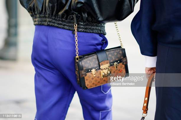 A guest wears a Louis Vuitton bag outside Louis Vuitton during Paris Fashion Week Womenswear Fall/Winter 2019/2020 on March 05 2019 in Paris France