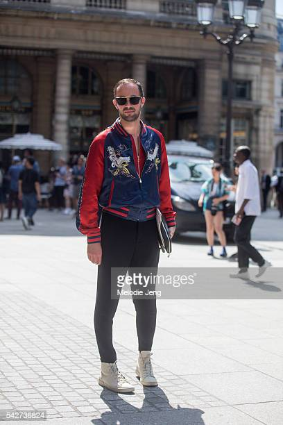A guest wears a Louis Vuitton jacket' during Paris Men's Fashion Week SS17 on June 23 2016 in Paris France