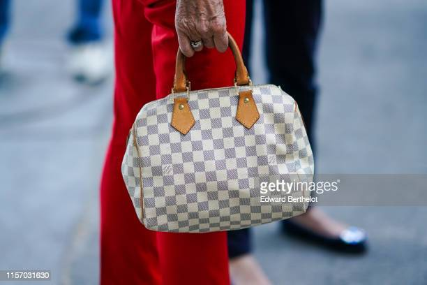 A guest wears a Louis Vuitton speedy bag outside AMI during Paris Fashion Week Menswear Spring/Summer 2020 on June 18 2019 in Paris France