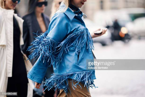 Guest wears a lustrous fringed blue leather jacket, outside Haider Ackermann, during Paris Fashion Week Womenswear Fall/Winter 2019/2020, on March...