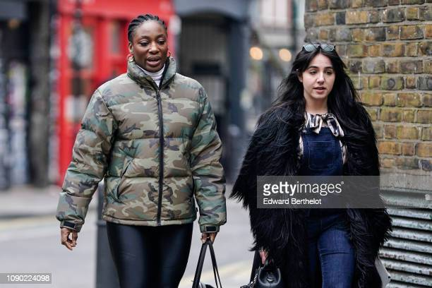 Guest wears a military camouflage puffer winter jacket ; a guest wears sunglasses and a black fluffy coat, a blue denim jumpsuit, during London...