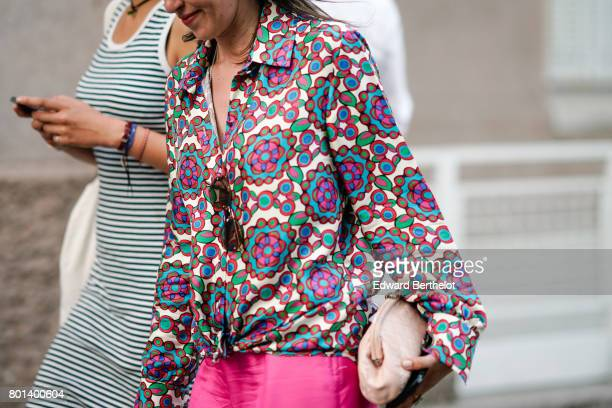 A guest wears a multi color shirt pink pants a pink bag outside the Kenzo show during Paris Fashion Week Menswear Spring/Summer 2018 on June 25 2017...