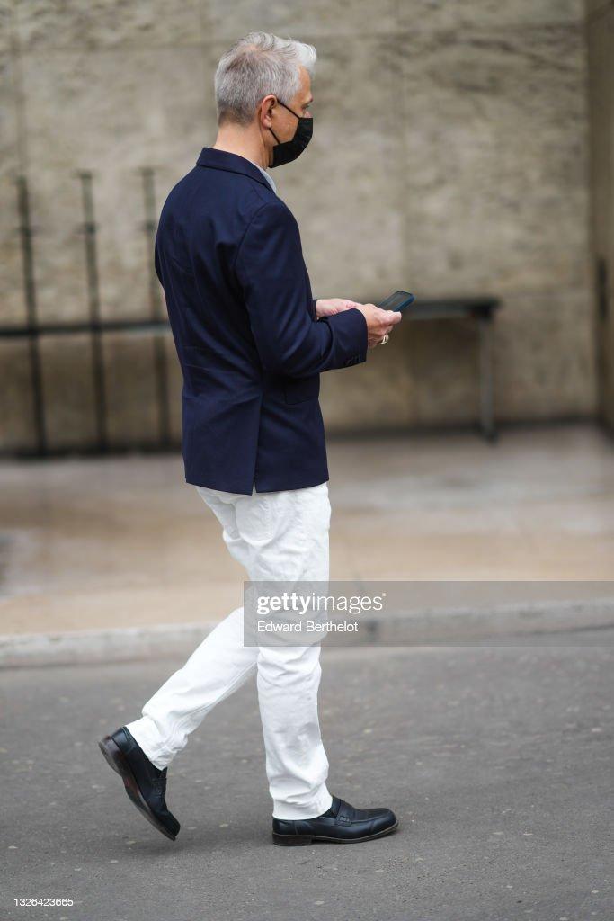 Navy blue blazer with white pants