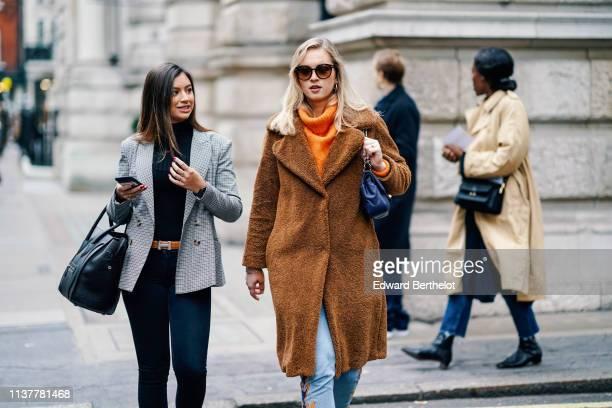 A guest wears a navy blue turtleneck navy blue pants a grey checkered jacket a Hermes belt a navy blue bag A guest wears sunglasses earrings an...