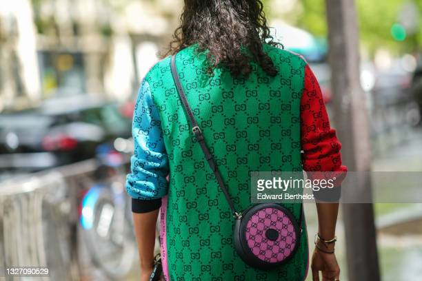 Guest wears a pale pink / blue / yellow / red / green with black GG monogram wool cardigan from Gucci, a black leather and pink GG monogram crossbody...