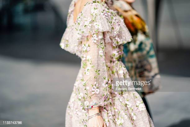 A guest wears a pale pink floral print ruffled and gathered tulle dress outside Giambattista Valli during Paris Fashion Week Womenswear Fall/Winter...