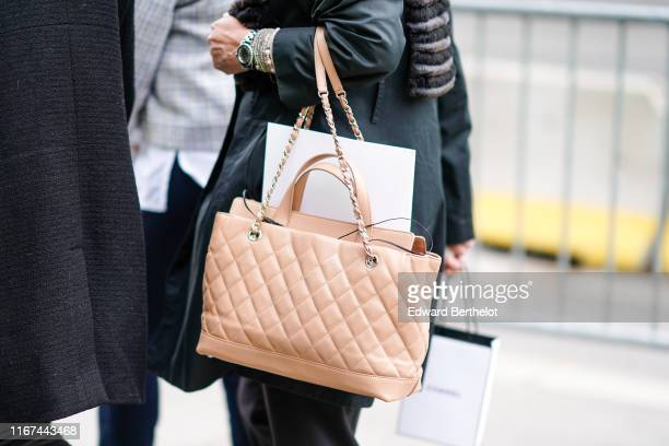 A guest wears a peachcolor Chanel bag outside the Chanel Cruise Collection 2020 At Grand Palais on May 03 2019 in Paris France