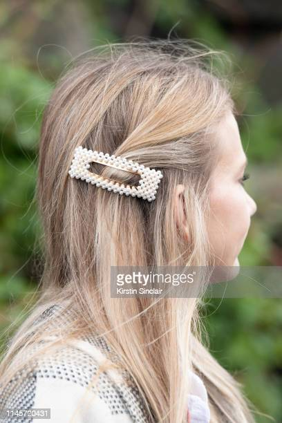 A guest wears a pearl hair clip on March 01 2019 in Paris France
