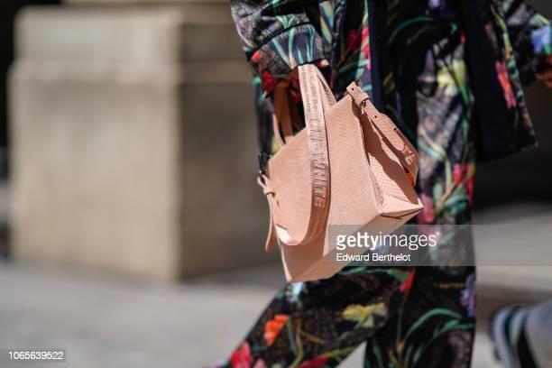 A guest wears a pik OffWhite bag outside Louis Vuitton during Paris Fashion Week Menswear SpringSummer 2019 on June 21 2018 in Paris France