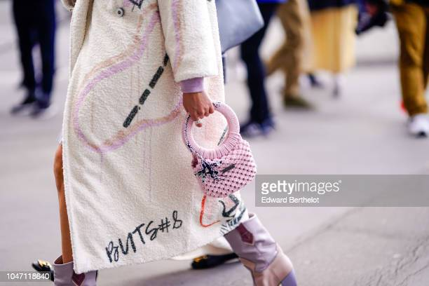 A guest wears a pink bag outside Giambattista Valli during Paris Fashion Week Womenswear Spring/Summer 2019 on October 1 2018 in Paris France