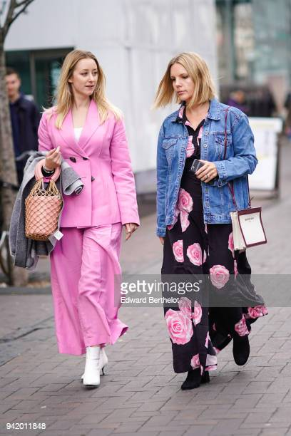 A guest wears a pink blazer jacket a bag pink flare pants white shoes a guest wears a blue denim jacket a dress with floral prints during London...