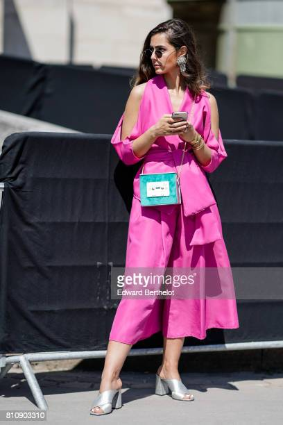 A guest wears a pink dress a green bag silver shoes outside the Chanel show during Paris Fashion Week Haute Couture Fall/Winter 20172018 on July 4...