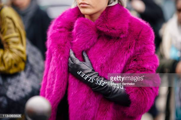 A guest wears a pink faux fur coat black leather gloves outside Haider Ackermann during Paris Fashion Week Womenswear Fall/Winter 2019/2020 on March...