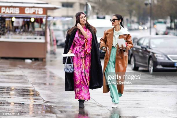 A guest wears a pink headband a pink satin floral print kimono dress blue jeans a blue bag a guest wears a brown trench coat green flare pants during...