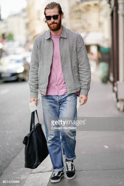 A guest wears a pink top a gingham vichy jacket blue pants outside the Thom Browne show during Paris Fashion Week Menswear Spring/Summer 2018 on June...