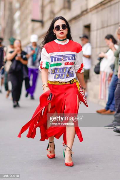 A guest wears a Pirelli top a red fringed skirt outside Y3 during Paris Fashion Week Menswear SpringSummer 2019 on June 24 2018 in Paris France
