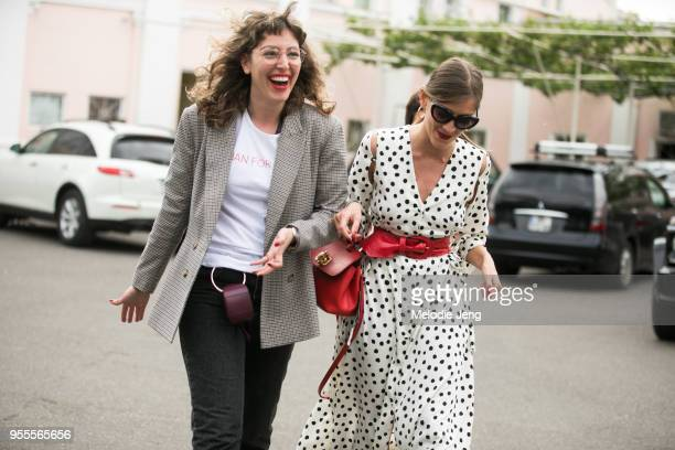 A guest wears a plaid jacket and white shirt and small belt bag Nuki Chabukiani of Materiel wears a white dress with black polkda dots and a red belt...