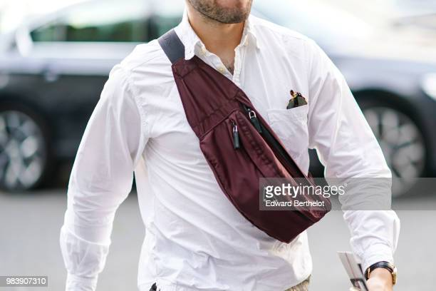 A guest wears a Prada burgundy shoulder strap bag outside 1017 ALYX 9SM during Paris Fashion Week Menswear SpringSummer 2019 on June 24 2018 in Paris...
