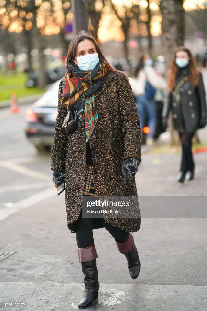 Street Style - Paris Fashion Week - Haute Couture Spring/Summer 2021 : News Photo