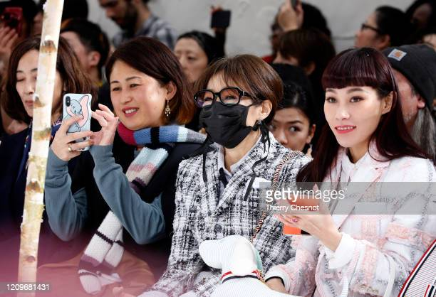 Guest wears a protective mask during the Thom Browne as part of the Paris Fashion Week Womenswear Fall/Winter 2020/2021 on March 01, 2020 in Paris,...