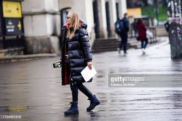 A guest wears a puffer jacket outside Elie Saab during Paris Fashion Week Haute Couture Spring Summer 2020 on January 23 2019 in Paris France