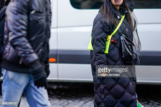 A guest wears a puffer jacket outside Off White during Paris Fashion Week Menswear Fall Winter 20182019 on January 17 2018 in Paris France