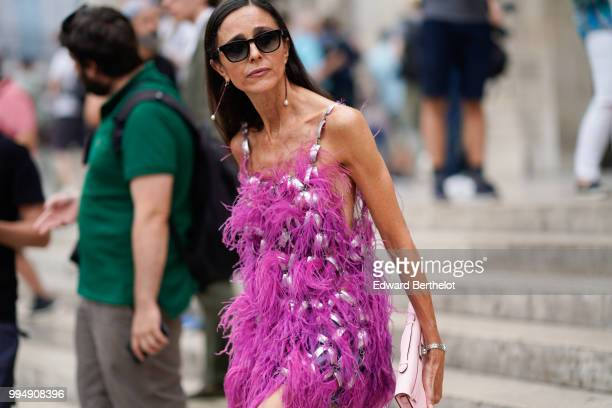 A guest wears a purple and pink faux fur dress outside Schiaparelli during Paris Fashion Week Haute Couture Fall Winter 2018/2019 on July 2 2018 in...