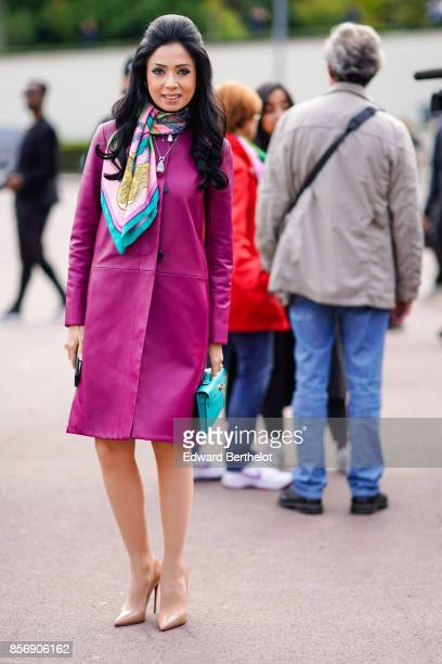 A guest wears a purple coat a color scarf outside Hermes during Paris Fashion Week Womenswear Spring/Summer 2018 on October 2 2017 in Paris France