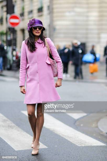 A guest wears a purple hat sunglasses a pink coat outside the JOUR/NE show during Paris Fashion Week Womenswear Fall/Winter 2017/2018 on February 28...