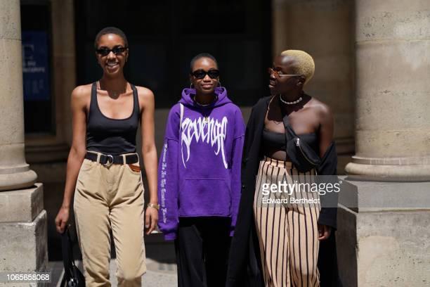 A guest wears a purple hoodie sweater outside Louis Vuitton during Paris Fashion Week Menswear SpringSummer 2019 on June 21 2018 in Paris France