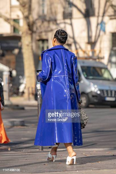 A guest wears a Purple patent trench coat on February 27 2019 in Paris France
