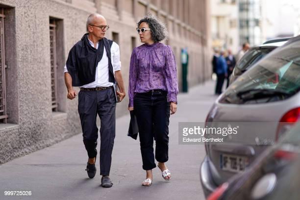 A guest wears a purple shirt outside Wooyoungmi during Paris Fashion Week Menswear SpringSummer 2019 on June 23 2018 in Paris France