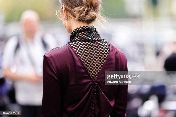 A guest wears a purple silky dress with a fishnet part outside Issey Miyake during Paris Fashion Week Womenswear Spring/Summer 2019 on September 28...