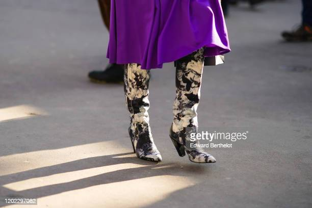 Guest wears a purple skirt, black and white floral print boots, outside Elie Saab, during Paris Fashion Week - Haute Couture Spring/Summer 2020, on...