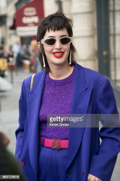 A guest wears a purple suit day 1 of Paris Womens Fashion Week Spring/Summer 2018 on September 26 2017 in London England