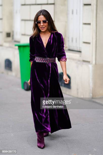 A guest wears a purple velvet dress outside Giambattista Valli during Paris Fashion Week Womenswear Spring/Summer 2018 on October 2 2017 in Paris...