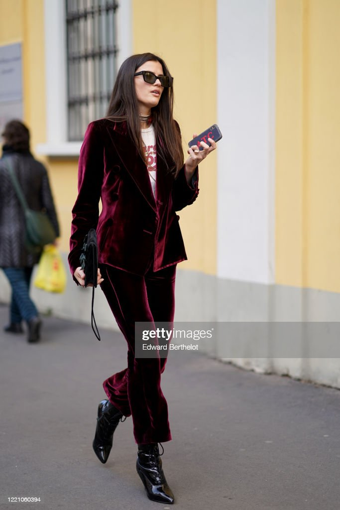 A Guest Wears A Purple Velvet Jacket Flare Pants Black Leather News Photo Getty Images